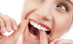 woman-flossing-white-teeth-1719170_441x269